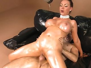A Deviant Cougar Is Getting Her Assets Oiled Up And Penetrated