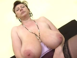 Buxom Cougar Jana P. Licks And Plays With Her Humongous Bra-stuffers