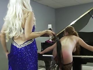 Non-traditional Blonde Cougar Mistress Penalizes Her Servant Piano Students