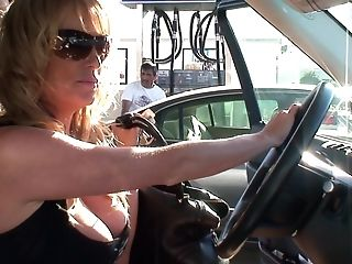 Kelly Madison Thumbs Her Clean-shaven Vagina While Driving